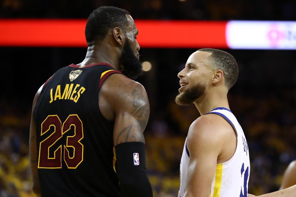 2f199210bc987 LeBron James and Stephen Curry exchange words during Game 1 of the 2018 NBA  Finals. Photo courtesy of Getty Images.